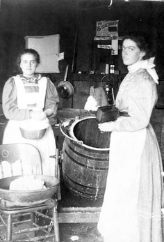 Two women in a kitchen, churning butter, ca. 1898. Dunbar History Project