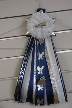 peewee mums... seem simple and inexpensive enough for their first homecoming!