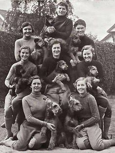 "World War II ""girls"" with their Airedales. These Airedales were used in World War II as sentry (guard) dogs. This photo most likely is English. Members of the Women Auxiliary Territorial Services cared for the dogs and exercised them; although the actual training was done by men (remember, this was in the forties)"
