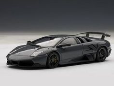 This Lamborghini Murcielago SV Diecast Model Car is Telesto Grey and features working wheels. It is made by AUTOart and is scale (approx. Lamborghini Models, Volkswagen Group, Thing 1, Diecast Model Cars, Expensive Cars, Car In The World, Hot Cars, Exotic Cars, Scale Models