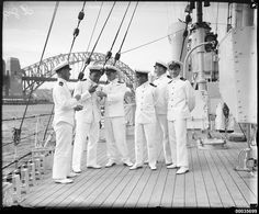 This photograph depicts Royal Indian Navy officers of the sloop HMIS HINDUSTAN probably during their 1934 visit to Australia. This photograph was taken at wharf 3, East Circular Quay in Sydney after the ship arrived on 29 November. The vessel departed Sydney for Brisbane at 10:38am on 7 December. HINDUSTAN was stationed in Australian waters to act as an escort for ships attending the Victorian centenary celebrations in October 1934.  This photo is part of the Australian National Maritime…