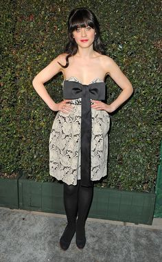 Big Black Bow from Zooey Deschanel's Best Looks  At the My Valentine video premiere, Zooey donned an adorable Stella McCartney frock that featured a huge accent bow. She kept the short dress classy by pairing black tights underneath.