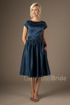 Trinity | Fun and fashionable! This new bridesmaids dress will flatter a variety of figures with the slimming ruched waistband and the tightly pleated skirt.    Style Love: The newest trends are all about the higher bateau neckline, and we are loving it!    Dress shown in Slate Blue, Matte Satin fabric.    Available at LatterDayBride.com or In Store at Gateway Bride | Home of the LatterDayBride Collection in SLC, UT