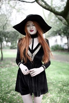 Olivia Emily wears Dark Thorn Clothing Victoria Dress, Asos Floppy Wide Brim Hat, Rogue and Wolf Jewellery, and Ash Boots