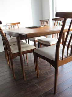 Extending dining table and chairs, by John Herbert of Younger furniture