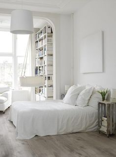 minimalist bedroom with crate as a nightstand