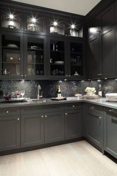Gorgeous dark kitchen design with oak wood floors, black shaker kitchen cabinets, gray quartz countertops and glass-front black glass tiles backsplash. the lighting makes this too dark kitchen amazingly inviting, Shaker Kitchen Cabinets, Grey Cabinets, Kitchen Backsplash, Upper Cabinets, Backsplash Ideas, Pantry Cabinets, Glass Cabinets, Grey Backsplash, Floors Kitchen