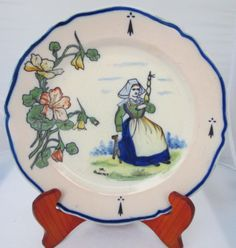 Botanical plate with a charming Bretonne from Quimper. Hand painted French faience! Photo courtesy of countryfrenchpottery.com. Join our mailing list!