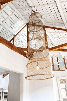 A while back we admired this vintage fishing basket repurposed as a pendant light, spotted in the home of Hitoshi Uchida. Pendant Lamp, Pendant Lighting, Chandelier, Barn Lighting, Net Lights, Hanging Lights, Diy Luminaire, Basket Lighting, Vintage Fishing