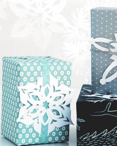 Paper snowflakes are always fun to create with the kids. Each one is always a little bit different! They're perfect to create garland or use as a gift tag for the holidays.