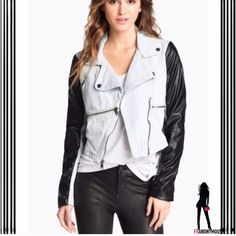 """White Denim Black Leather Moto Jacket M By Steve Madden. New with tag mixed media/color two tone, two texture update to the classic cropped moto jacket silhouette. Sleeves and trim are subtle black vegan leather and body is bleached white denim. Asymmetrical zipper detail on back adds a touch of edge. Laying flat one side underarm to underarm is 18"""". Shoulder seam to seam is 15.5"""", length from shoulder to hem in front 20"""" Asymmetrical front zipper closure and zippered chest pockets. Fully…"""