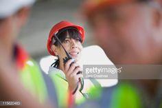 Stock Photo : Architect speaking into walkie-talkie