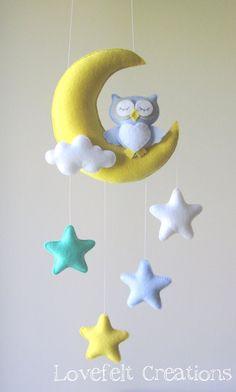 ♥ WELCOME TO LOVEFELT CREATIONS ♥  All my mobiles are made with much love, with a great amount of care and consideration invested in their design and production. DETAILS AND DIMENSIONS: ======================= Each plush element is created with felt, lightly filled with hypo-allergenic polyester stuffing.   The moon measures 8x6.5 and enclosed there is a long string for ceiling hanging. (Please use a secured hook!) the stars 3x3. Owl 5x4.5.  Overall installed size measures approximately…