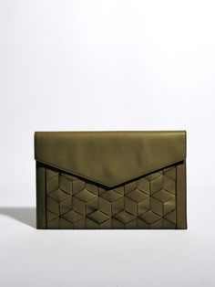 Slim in silhouette and elegant in composition, the Mingle Clutch in military green leather embodies simplicity and sophistication in delicate balance. Rich leather is handwoven in a sumptuous hexagon texture to create the sleek statement piece, one that slides easily under the elbow or fits perfectly in hand for brunches, evening occasions and every event in between. #weldenbags