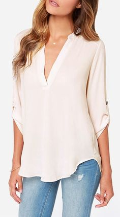 Need a white/off-white blouse with a not-too-deep V-neck. No collar, no front buttons, no cross over fabric