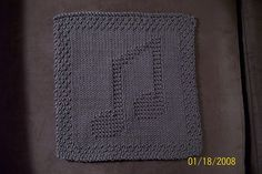 an adaptation of Knitted Music Notes Cloth ©copyright 2005 by Rhonda K. White  materials: 100% cotton yarn and size 7 knitting needles B = Moss stitch border Finished size = 9″ x 9″ C…
