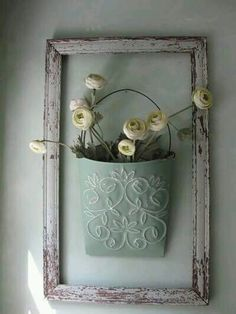 shabby farmhouse light blue decor - rustic empty frame with tin pot of flowers