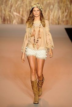 Modern Hippie Chic model wearing gypsy feather necklace with boho leather boots & flower headband. For the BEST Bohemian fashion trends for 2014 FOLLOW http://www.pinterest.com/happygolicky/the-best-boho-chic-fashion-bohemian-jewelry-gypsy-/