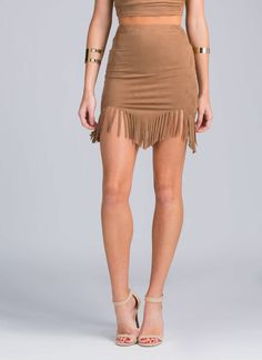 If you believe yourself to be a boho princess, we better be able to find this faux suede fringe skirt in your closet.