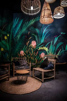 Jungle illustration printed on wallpape to decorate the interior of the lounge area of a wine bar.