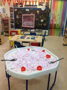Sensory Play 'Clean Mud' – grated soap, shredded tissue paper, raspberry bubble bath, pink food coloring, and water. Mix together and leave to set over night. Children will adore the smell and texture of this clean mud. Add some confetti hearts and shapes for a Valentine's day theme. Provide spatulas and scoops to develop hand eye coordination and exploration of the textures.