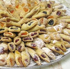 Polish Cookies Kolaczki- for Christmas  1 (8-ounce) cream cheese, softened 12 oz (3 sticks) butter, softened 3 C all-purpose flour 2 (14-oz) cans fillings of choice (apricot, prune, raspberry, etc.) Confectioners' sugar 350 degrees for 15 min.