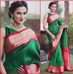 Emerald green silk sari with a fuchsia pink border and pallu.