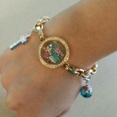 Our #lovely #customized #charm #bracelet :) #faith #hope #skyblue :)) Bracelet Chain $24, Link Locket $36, Dangles $6-14, Gold Cross Charm $5, Aqua Cards $5, Pink Hope Charm $5, Pink Puffy Heart $5, Aqua stones $5, Pink stones $5, Pink Princess Crown $5. =) frocketsandlockets.com ☆☆☆