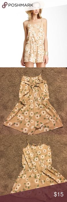 Fifty street sunflower romper Size: large   Color: tan with white flowers; this romper is perfect for everything! The super cute tie up back adds a beautiful touch along with the pretty sunflower details. Worn a few times and is in very good condition! Fifty street Other