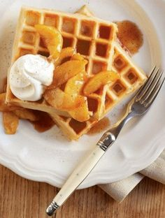 Cinnamon Waffles with Caramelized Apples | Caramelized apples and whipped cream transform cinnamon-spiced waffles into a luxurious brunch dish. Serve a stack of these treats on a leisurely morning — the whole family will love them.