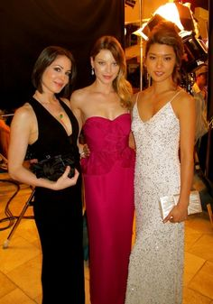Michelle Borth, Lauren German, and Grace Park during filming of the gala scene for Hawaii Five-0.