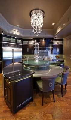 Stunning rounded center island and counter top in this kitchen...x