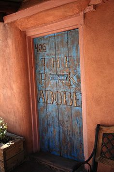 Santa Fe, New Mexico. Grand entrance to an adobe building in Santa Fe with a 17th century style.