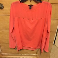 Studded coral top Loose fitted coral top with a few studded lined up at the top! Could be dressed up or worn casually! Great for any season because sleeves can be rolled up to below the elbow! H&M Tops Blouses