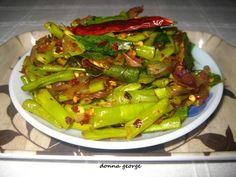 I love Yard long beans (Achinga payar) just like any other Keralite and I'm sure you must have come across the recipe I posted earlier with this yummy veggie. If not, you can find it here in Achinga Payar Mezhukuperatti/Yard Long Beans Stir Fry. I did promise you all that I would show you different