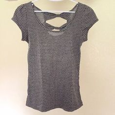 I just discovered this while shopping on Poshmark: Grey polka dot t-shirt with bows on the back. Check it out! Price: $9 Size: S