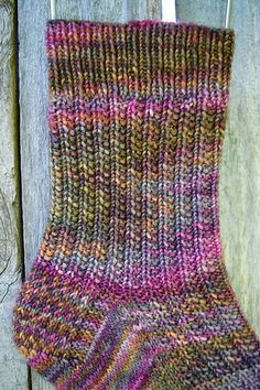 Village Socks are worked from the top down with an easy to memorize two row knit and purl pattern. This is a stretchy pattern so it will fit a variety of feet! The pattern includes an Eye of Partridge heel flap and traditional gusset.