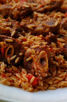 "LAMB! Greek dish ""arni youvetsi"" --lamb baked with pasta(Orzo) and tomato sauce with a hint of cinnamon!"