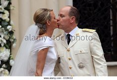 Prince Albert II and Princess Charlene of Monaco kiss at the Saint Devote church after leaving the bride's bouquet - Stock Image
