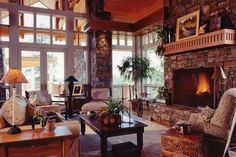 Comfy yet rustic mountain retreat Great Room with gorgeous stone fireplace. (Locati Architects)