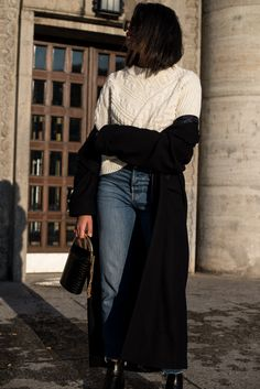 storm wears blue levis jeans with white edited the label sweater in berlin winter look