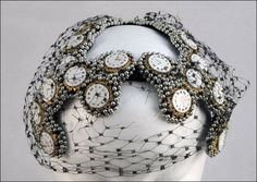 Bes-Ben 'Clock face' hat | United States, 1958 | Clock faces and metallic beads entirely cover intersecting bands