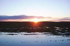 Zonsondergang   boven verdronken land