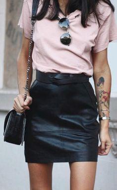 Pink tee shirt tucked into black pencil skirt. Sunglasses, silver bracelets, black bag
