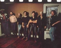 Bruce Springsteen AND the E-Street band Leaning on stuff!