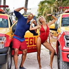 "The two most iconic #BAYWATCH characters of all time. ""Mitch Buchannon"" and ""CJ Parker"". Embodied by the dope and talented @kellyrohrbach and some big brown inked up bald dude who keeps showing up in these epic shots. #OnSet # #MitchAndCJ #EverythingSheDoesIsAlwaysInSloMo #WatchYourEyesBoys #BAYWATCH SUMMER 2017 by therock"