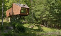 A perfect getaway surrounded by nature is hidden away near the town of Woodstock. UK-based Antony Gibbon Designs crafted this blissful retreat, called Inhabit Treehouse, that's nestled within dense forest less than a two-hour drive from New York City. Built from locally and sustainably sourced reclaimed timber, Inhabit treehouse offers beautiful and cozy digs with stunning views of a lake and the Catskills mountain range beyond.