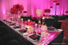 Mirror tabletop tables with hot pink and black accents from Keela and Marion's Las Vegas wedding reception. Destination wedding planning and design by Tiffany Cook Events
