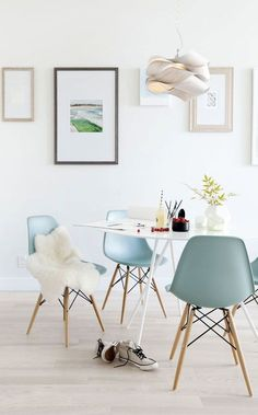 Add a hint of pastel to your dining area with dusty blue modern chairs. See more ideas for how to decorate with pastels on the Spruce + Furn blog. Image Source:Apartment 34