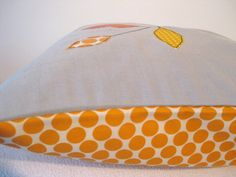 I make these cushion covers using free-motion applique, inspired by the bright colours in the trees as the seasons change. The fabrics are a mix of new cottons, all in bright oranges. The background of the front is a cotton linen blend, in a natural shade. The reverse is Amy Butler Lotus Full Moon, in tangerine, 100% new cotton. It has an envelope closure so you can easily switch your cushions around. This sunny and bright design would fit easily in to your living room, sunroom, babys…
